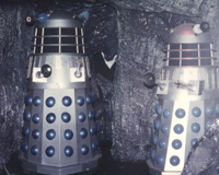 Dalek B1 (left) circles Dalek SM2 in 1979. Photo - Roger M Dilley