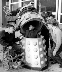 Children at the Warlies Dr. Barnardo's home play with one of their Daleks.