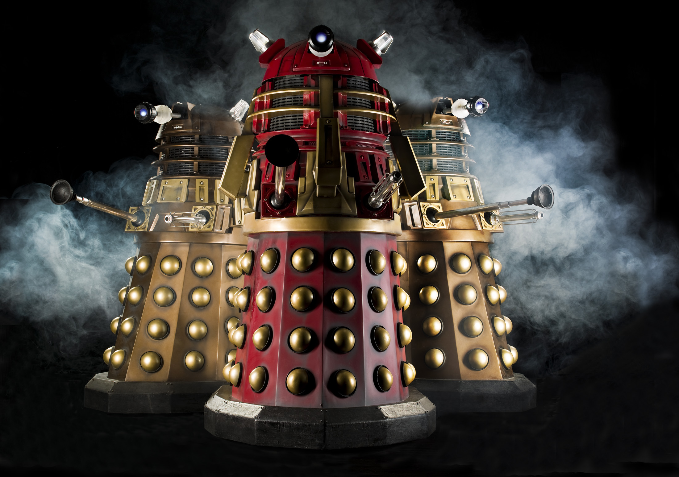 NSD4 and MT1 flank the Supreme Dalek in the Radio Times poster