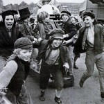 The cast of Oliver! play with a Dalek on the Shepperton backlot