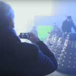 Peter Capaldi takes a picture while the six Daleks are readied.