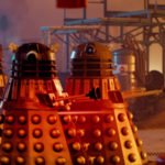 The toy Dalek about to be blown apart